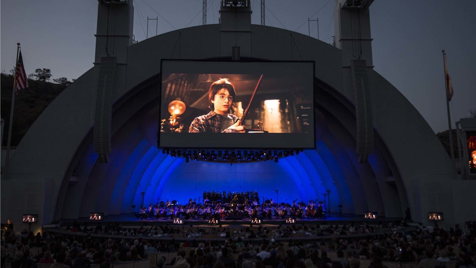 """The L.A. Philharmonic gives a live performance of John Williams' music for """"Harry Potter and the Sorcerer's Stone"""" during a screening of the film at the Hollywood Bowl on July 6, 2016. (Robert Gauthier / Los Angeles Times)"""
