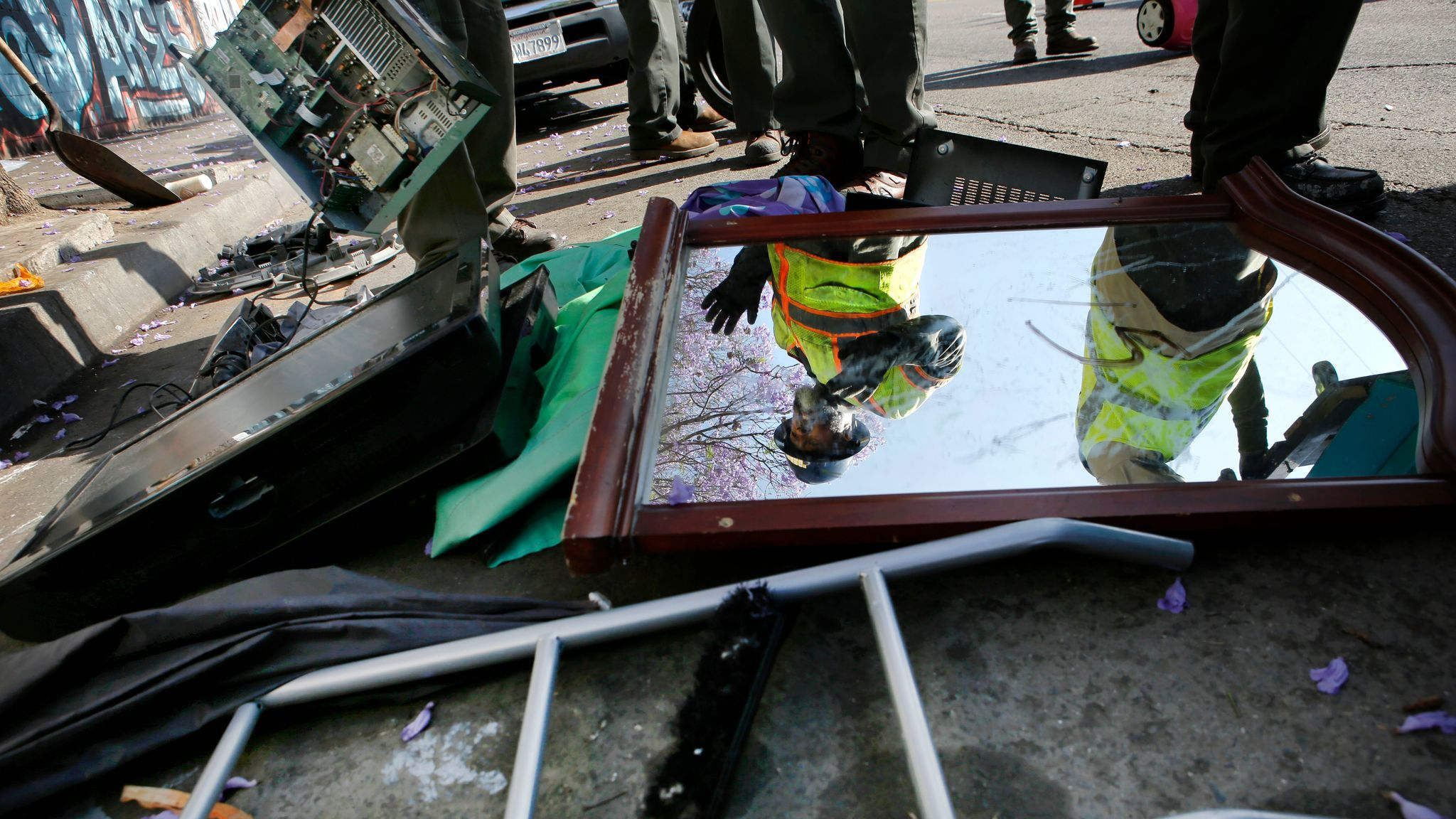 Sanitation workers dispose of waste during a sanitation cleaning in Los Angeles.