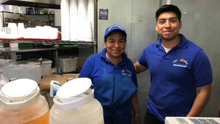 Yolanda Diego, and her son Ismael, behind the counter of their restaurant Tacomiendo in West Los Ang