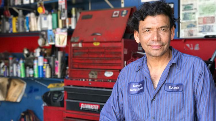 David Alvarez, who owns David's Auto Repair in West Los Angeles, worries he won't be able to find an