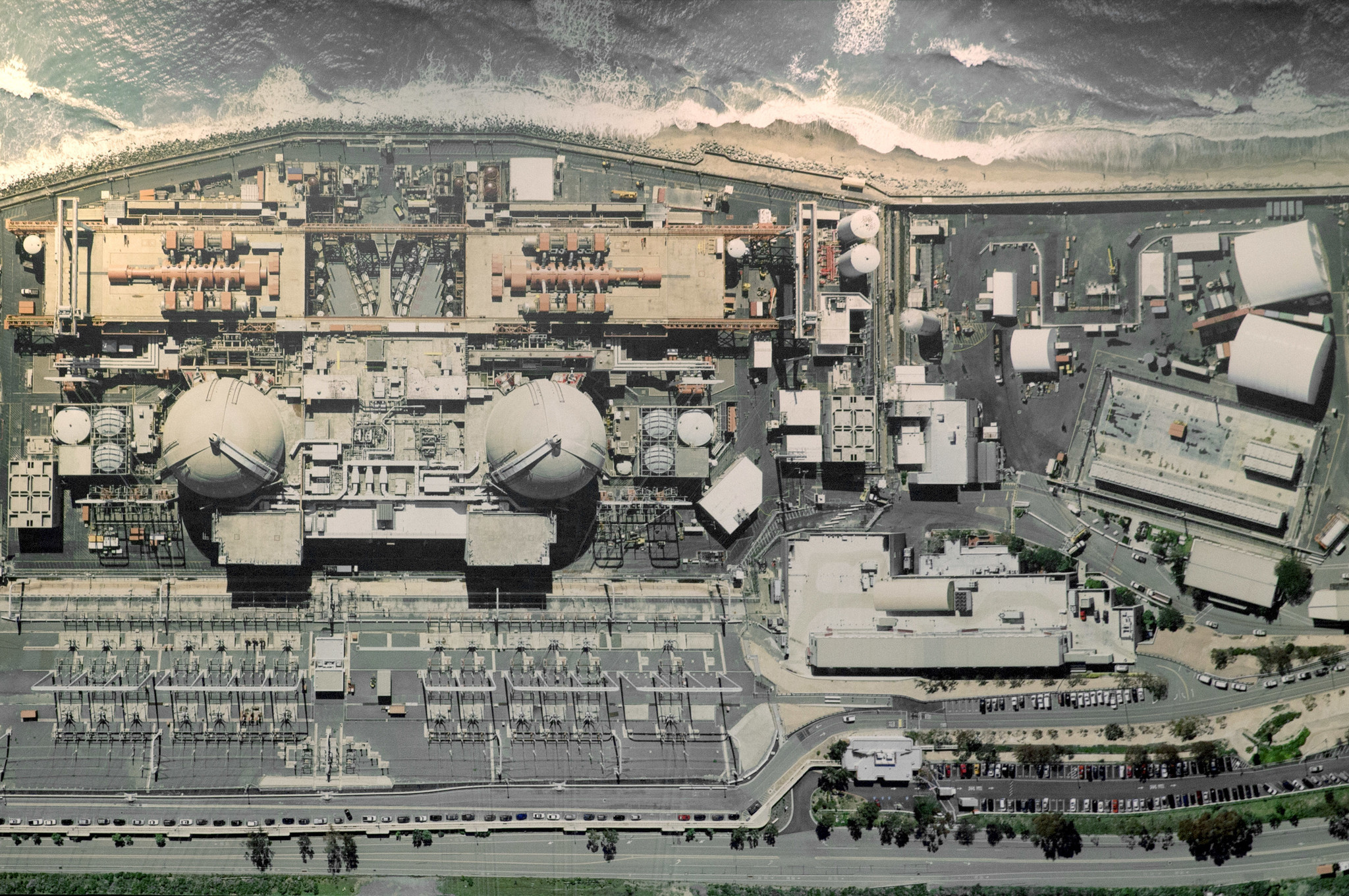 An aerial view of the closed San Onofre Nuclear Generating Station hangs on the wall of a conference room at the facility.