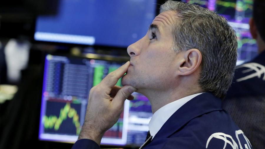 Specialist Anthony Rinaldi works at his post at the New York Stock Exchange.