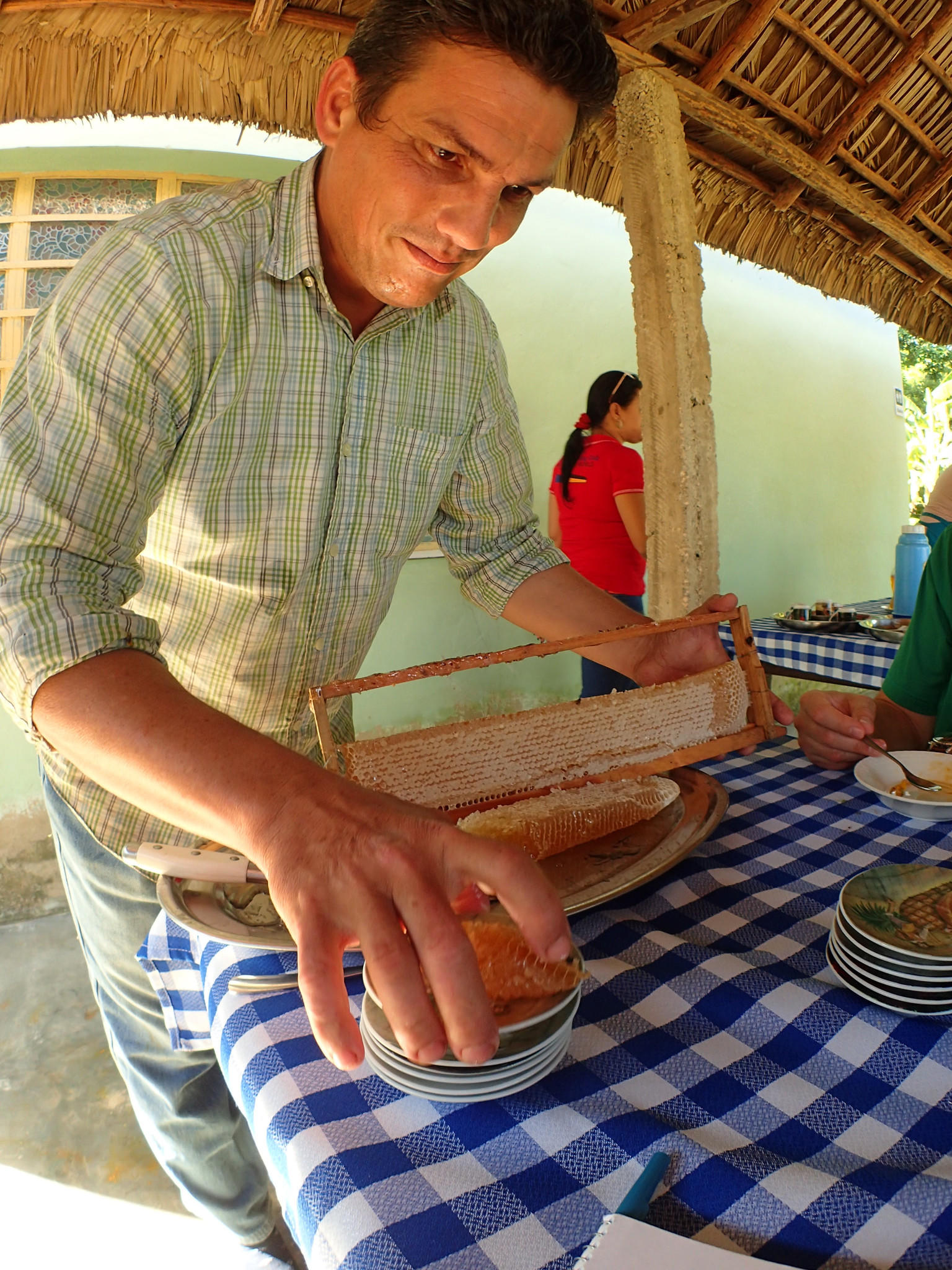 Fernando Funes serves chunks of honeycomb at Finca Marta, his organic farm located about an hour west of Havana.