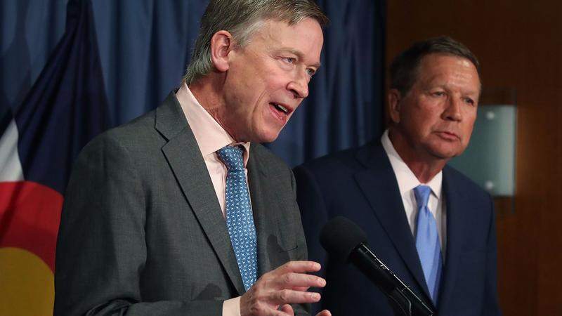 Gov. John Hickenlooper (D-Colo.), left, and Gov. John Kasich (R-Ohio) participate in a bipartisan news conference to discuss the Senate healthcare bill in Washington. (Mark Wilson / Getty Images)