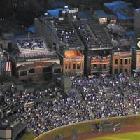 Cubs owners borrow more than $65 million on Wrigley rooftops