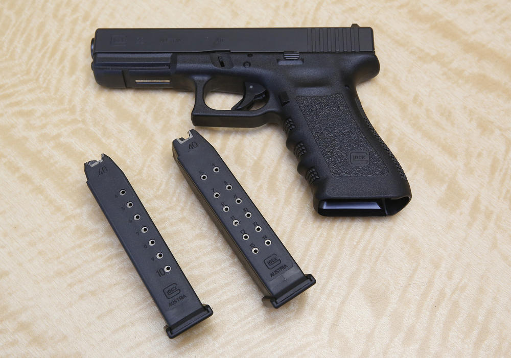 A handgun is displayed with 10- and 15-shot magazines. (Rich Pedroncelli / Associated Press)