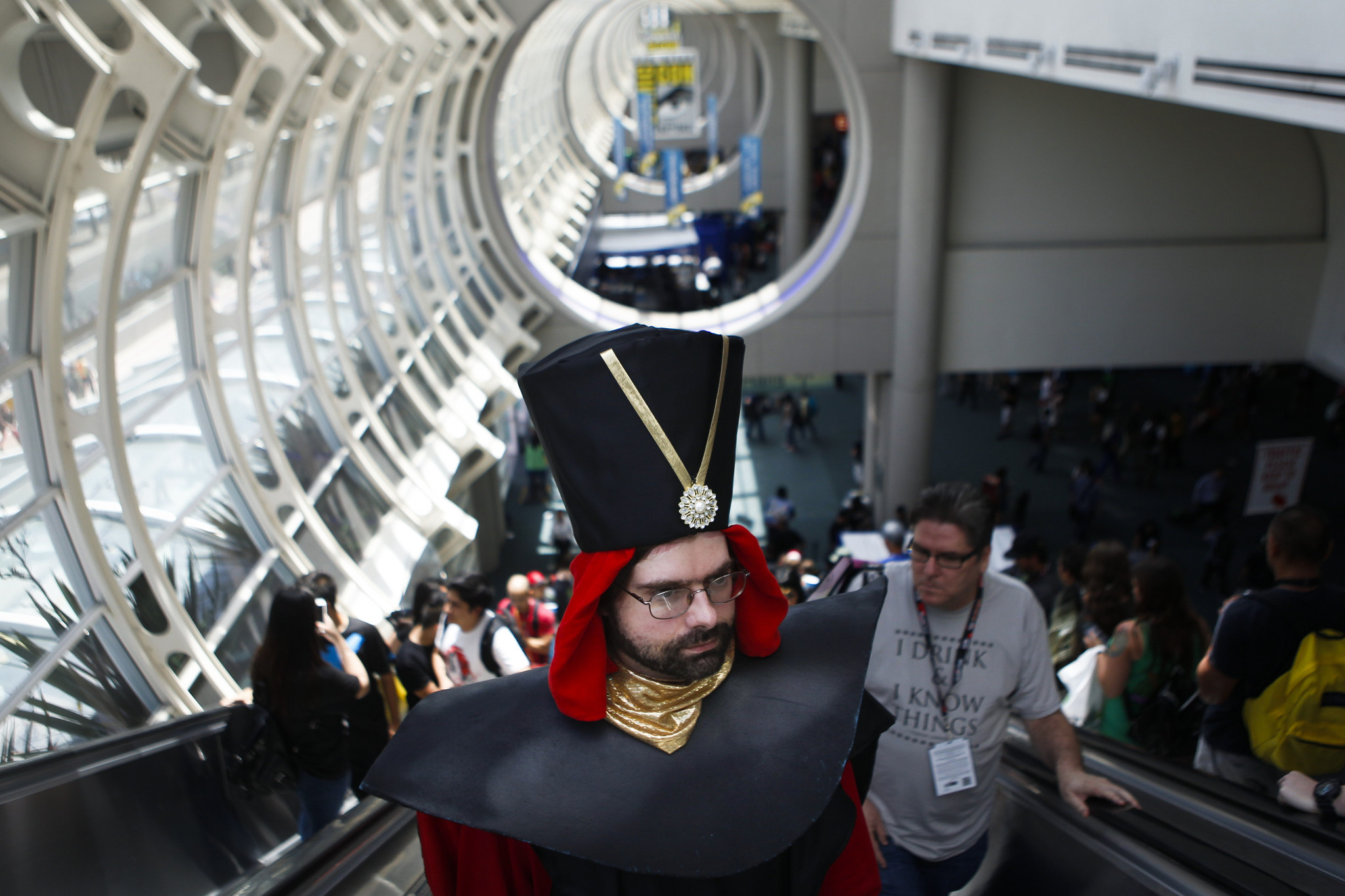 "Philip Brown (dressed as ""Aladdin"" villain Jafar) rides the escalator inside the San Diego Convention Center at Comic-Con 2016. (Harrison Hill / Los Angeles Times)"