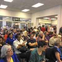 Emergency Evanston minimum wage hike meeting draws 150 people, including protesters