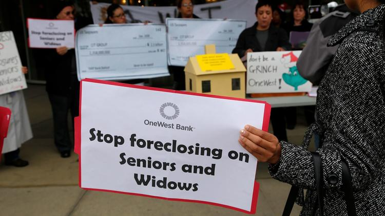 Protesters gather outside a OneWest Bank in Pasadena in 2014. (Gary Friedman / Los Angeles Times)