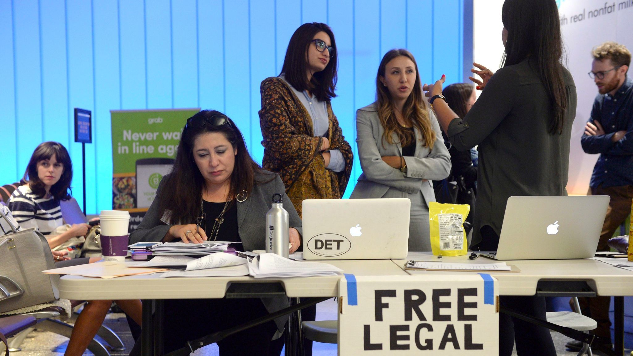 Immigration attorneys set up a table at Los Angeles International Airport as the new travel ban went into effect on Thursday.