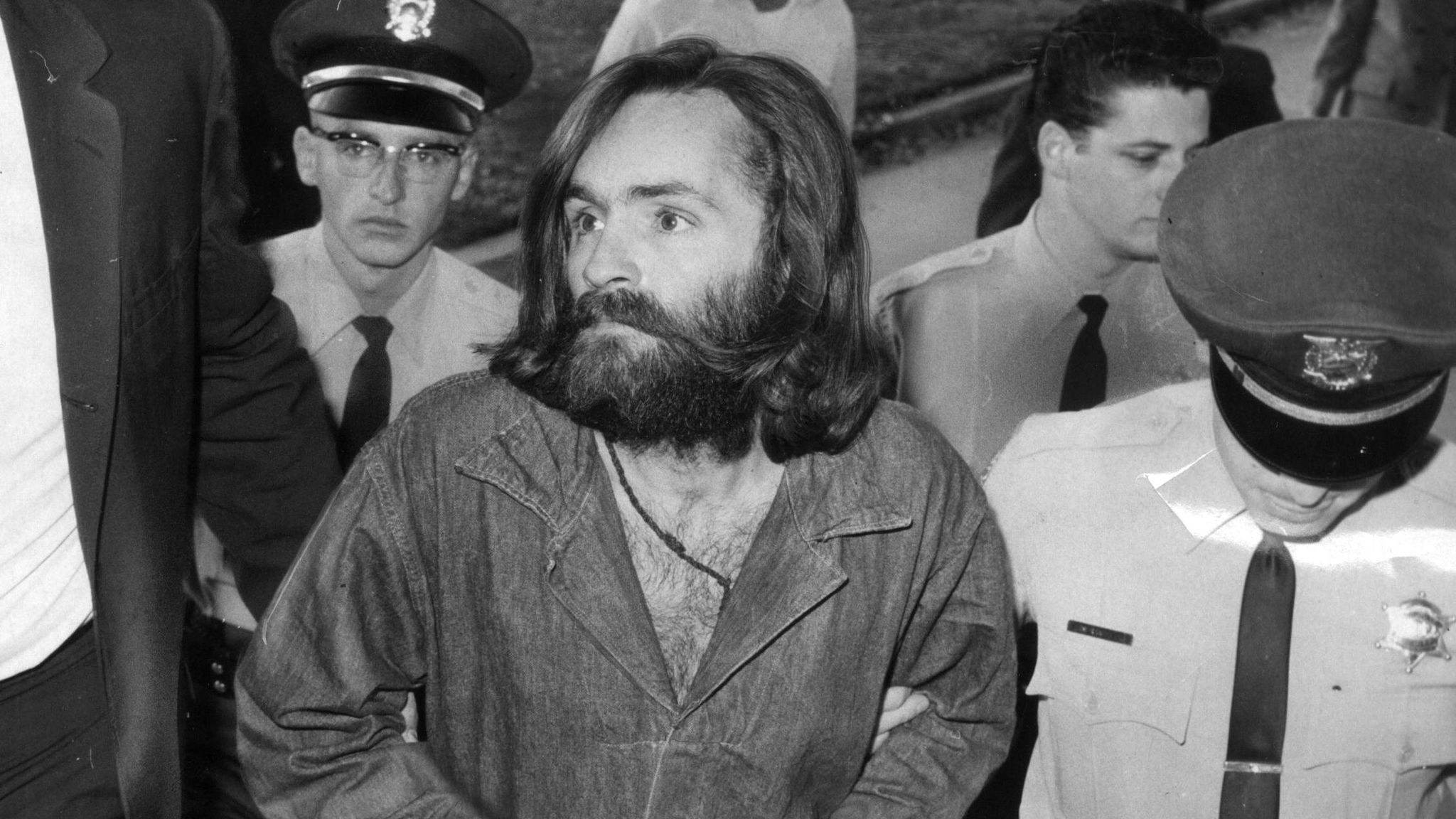 Charles Manson is escorted to court for a preliminary hearing in 1969.