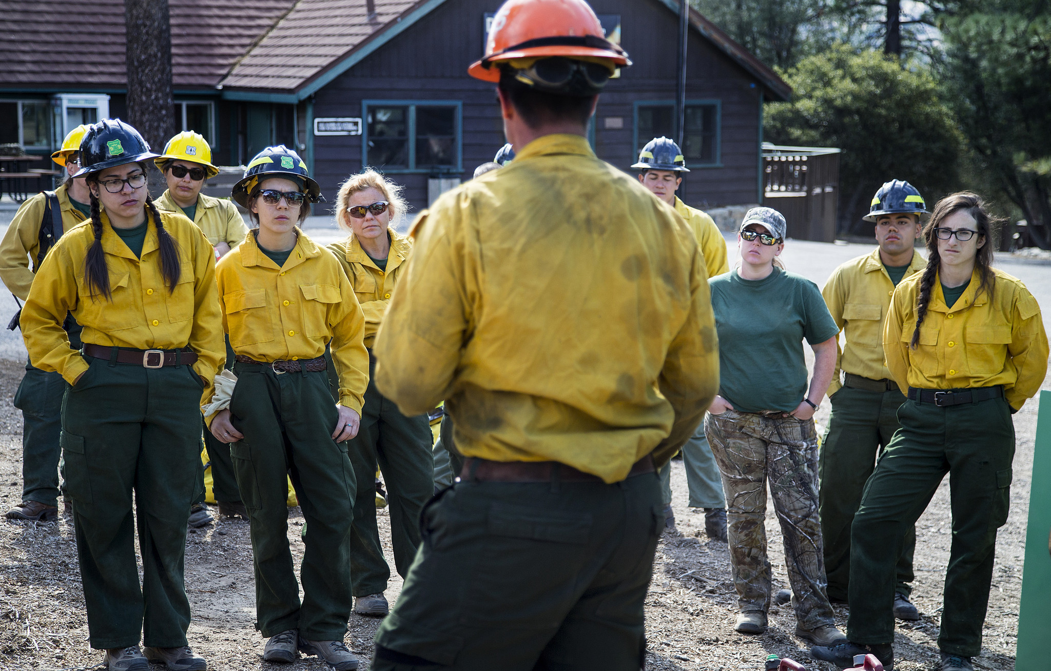 A firefighter from the U.S. Forest Service talks to the trainees about communications equipment and incendiary devices.