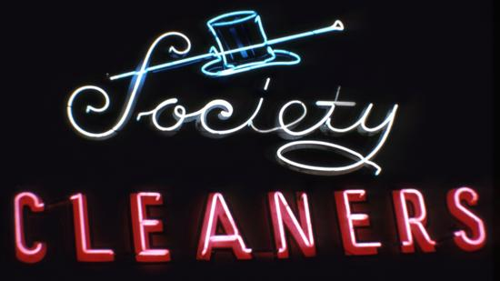 A dapper neon sign that once encouraged customers to have their clothes cleaned at Society Cleaners