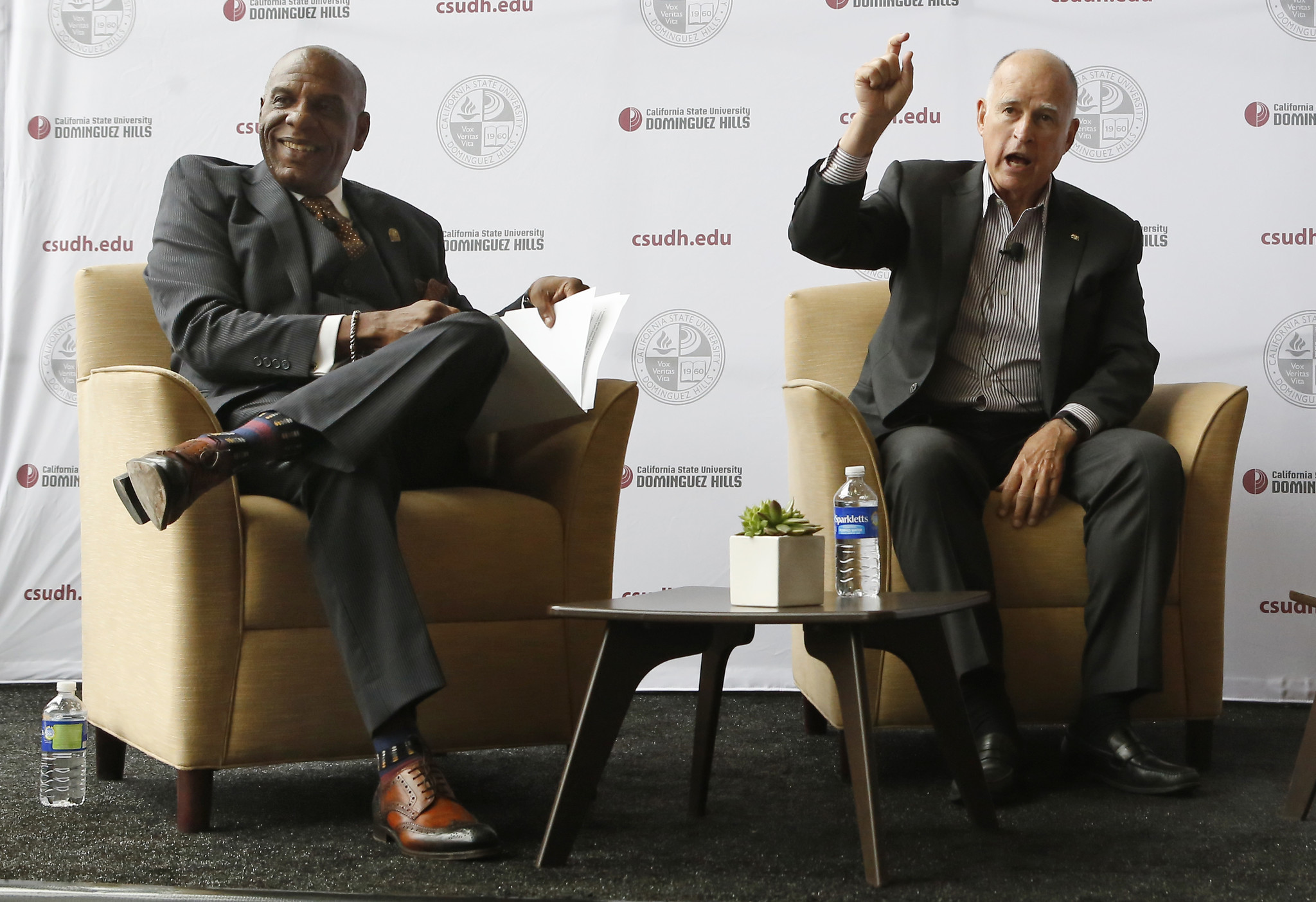 State Sen. Steven Bradford (D-Compton), left, and Gov. Jerry Brown talk about funding for projects under the state transportation bill, SB1, at Cal State Dominguez Hills in Carson. (Christian K. Lee/ Los Angeles Times)