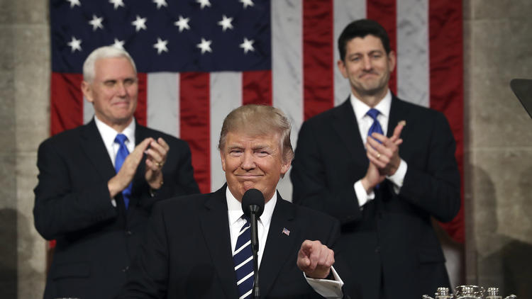 Trump is flanked by Pence and House Speaker Paul D. Ryan of Wisconsin during the president's address