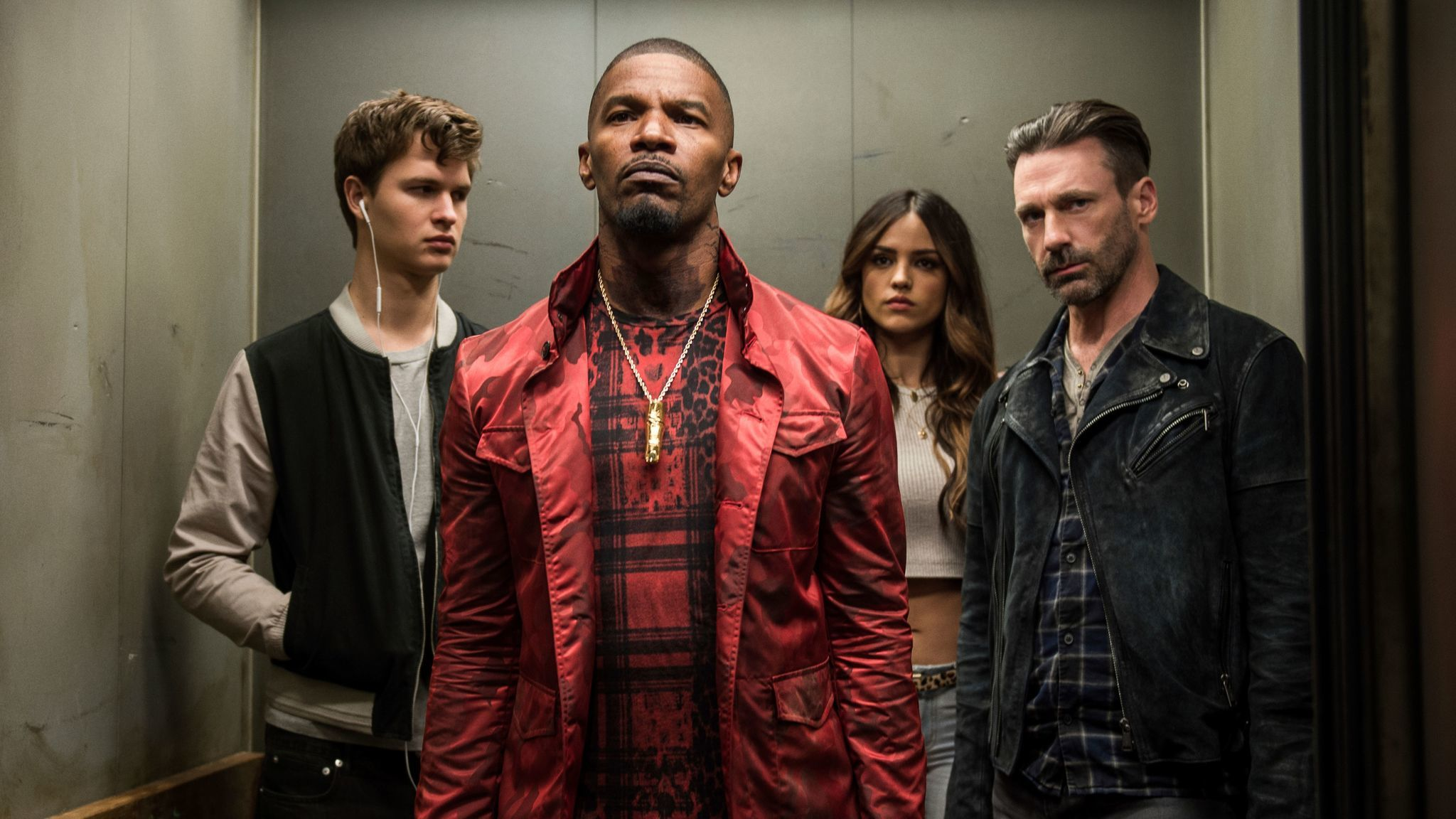 "Ansel Elgort, from left, Jamie Foxx, Eiza Gonzalez and Jon Hamm star as colorful criminals in Edgar Wright's action-musical ""Baby Driver."""