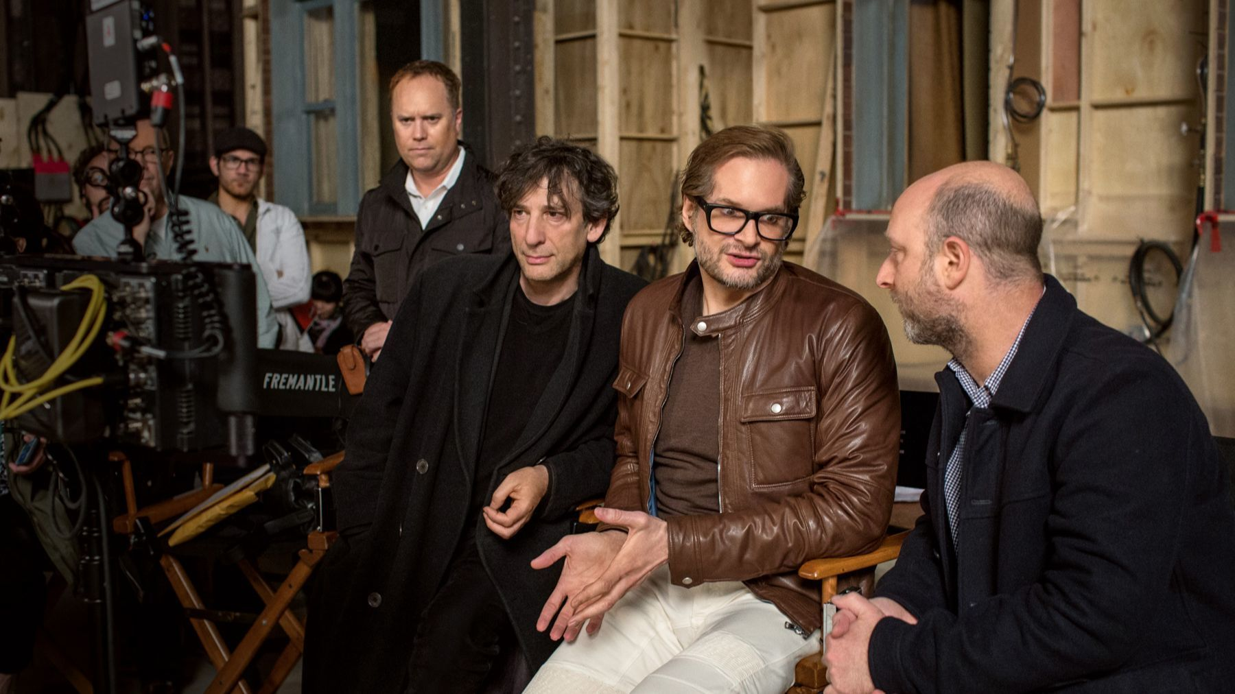 "Neil Gaiman, front left, Bryan Fuller and Michael Green on the set of ""American Gods."""