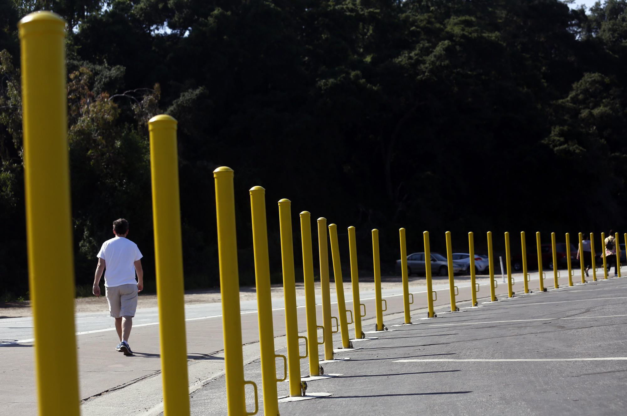 A man begins his walk south of the Rose Bowl stadium, near the corner of West Drive and Seco Street in Pasadena.