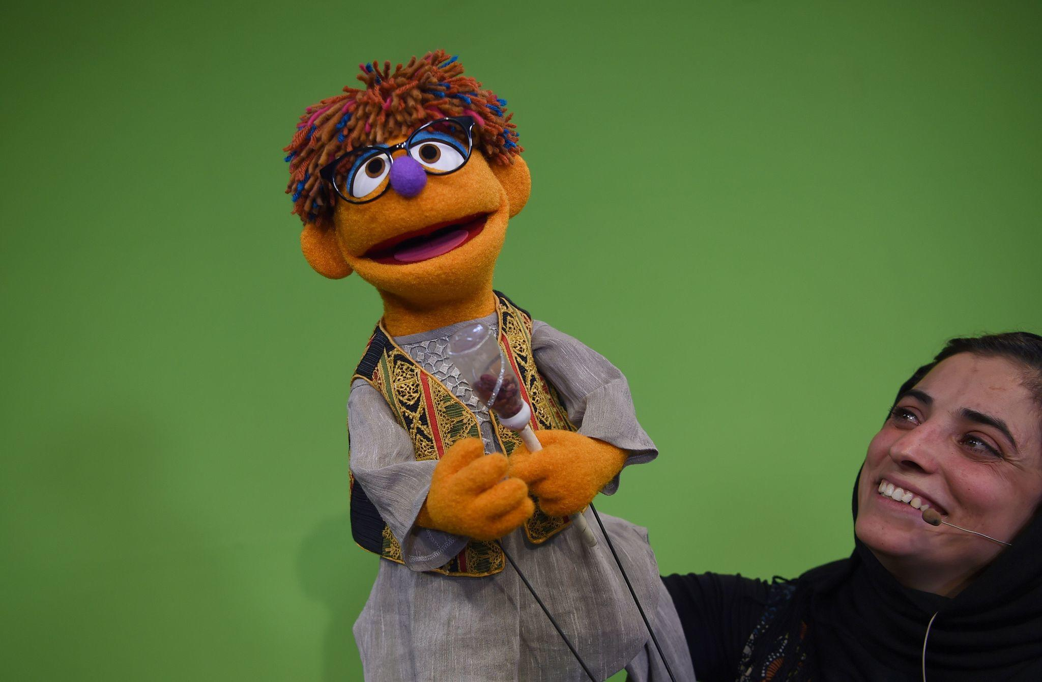 """Puppeteer Seema Sultani holds Zeerak, the new muppet on Afghanistan's """"Sesame Street"""" meant to promote education and gender equality. (Wakil Kohsar / AFP/Getty Images)"""