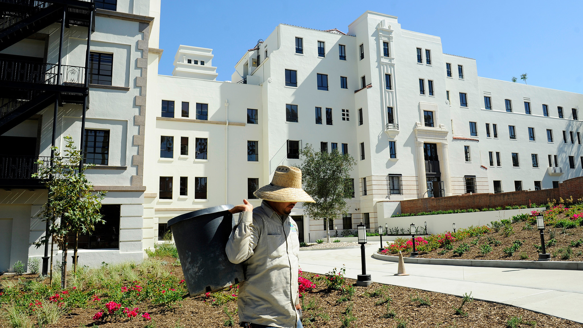 A gardener works in the yard at the former Linda Vista Hospital that is now affordable housing. (Christina House / For The Times)