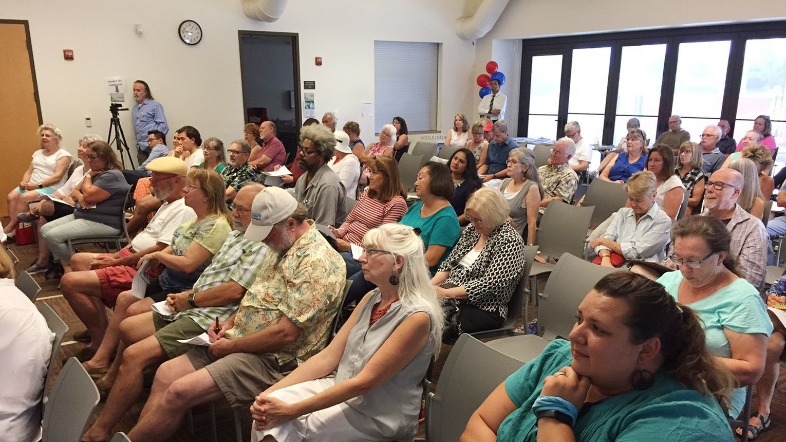 The audience at Indivisible Ramona's forum listens to the congressional candidates answer questions.
