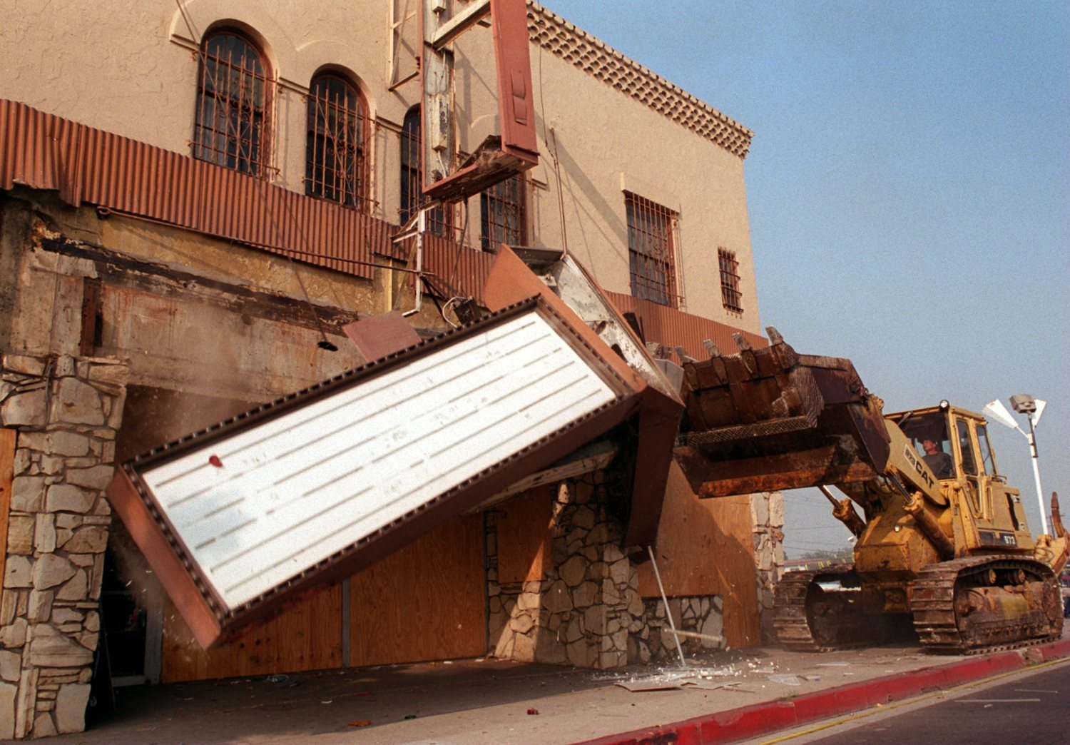 A bulldozer knocks down the marquee of the Pussycat Theater in Buena Park in 1995 after years of legal challenges.