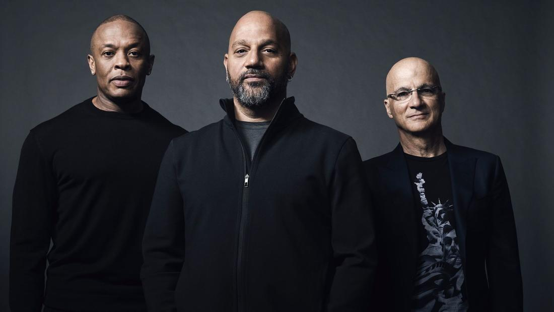 "From left: Dr. Dre, director Allen Hughes, and Jimmy Iovine are behind the HBO documentary ""The Defiant Ones."" (James Minchin / HBO)"