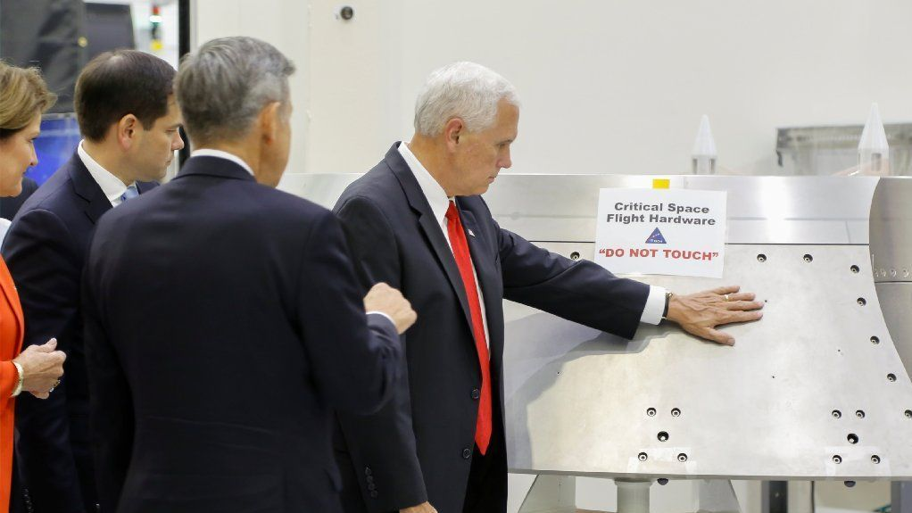 U.S. Vice President Mike Pence is shown a piece of hardware by Kennedy Space Center Director Robert Cabana during a tour of the Operations and Checkout Building in Florida July 6, 2017.
