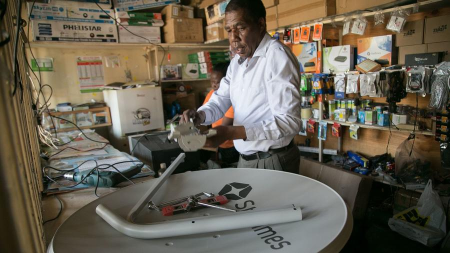 David Mugita is StarTimes' sole salesman in Kajiado, Kenya. StarTimes, a privately owned, Beijing-based media and telecommunications firm, has been sweeping across Africa since 2002. — Photograph: Immanuel Muasya/Los Angeles Times.