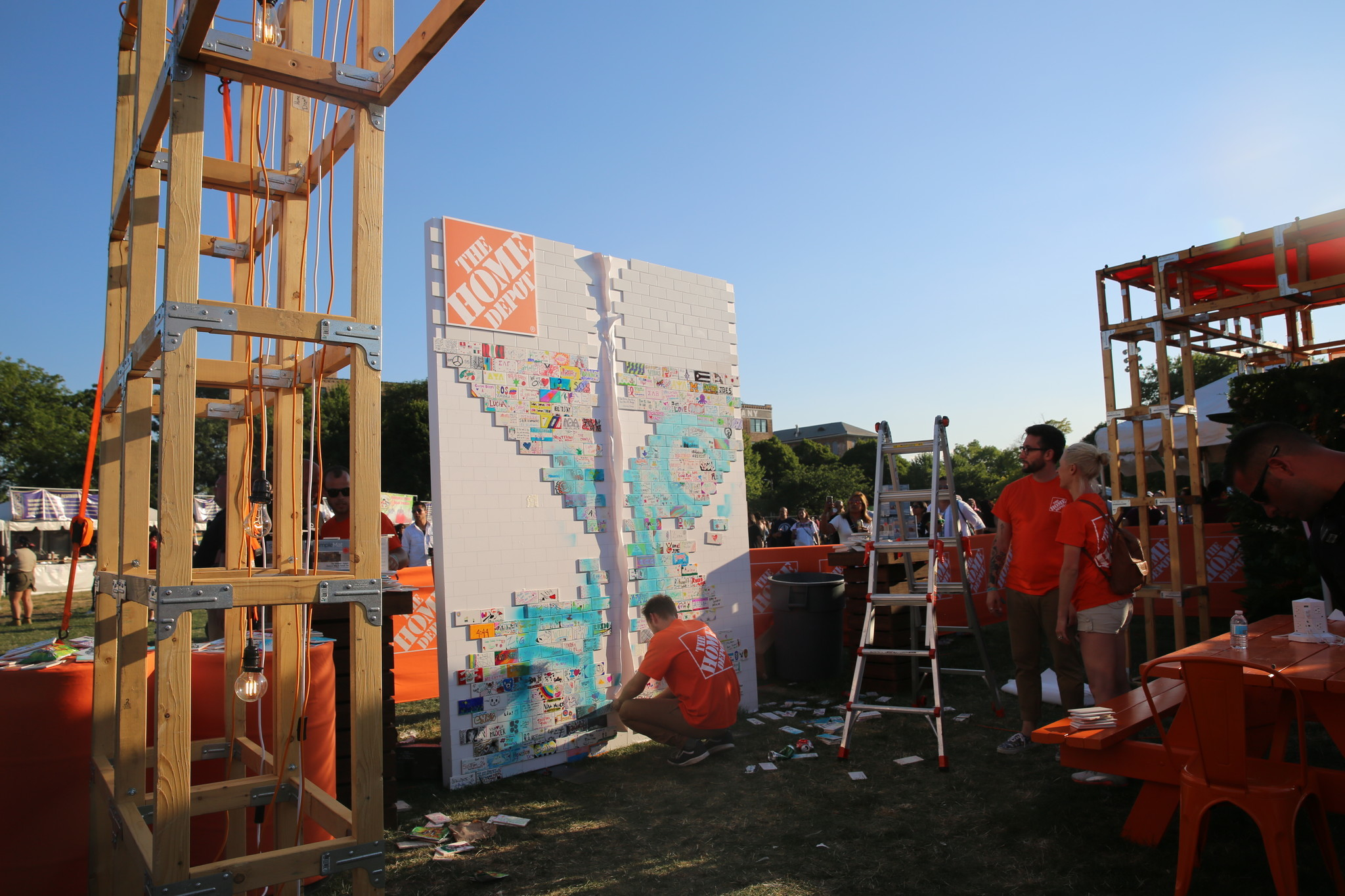 Protesters destroy wall at Home Depot booth during Latino rock