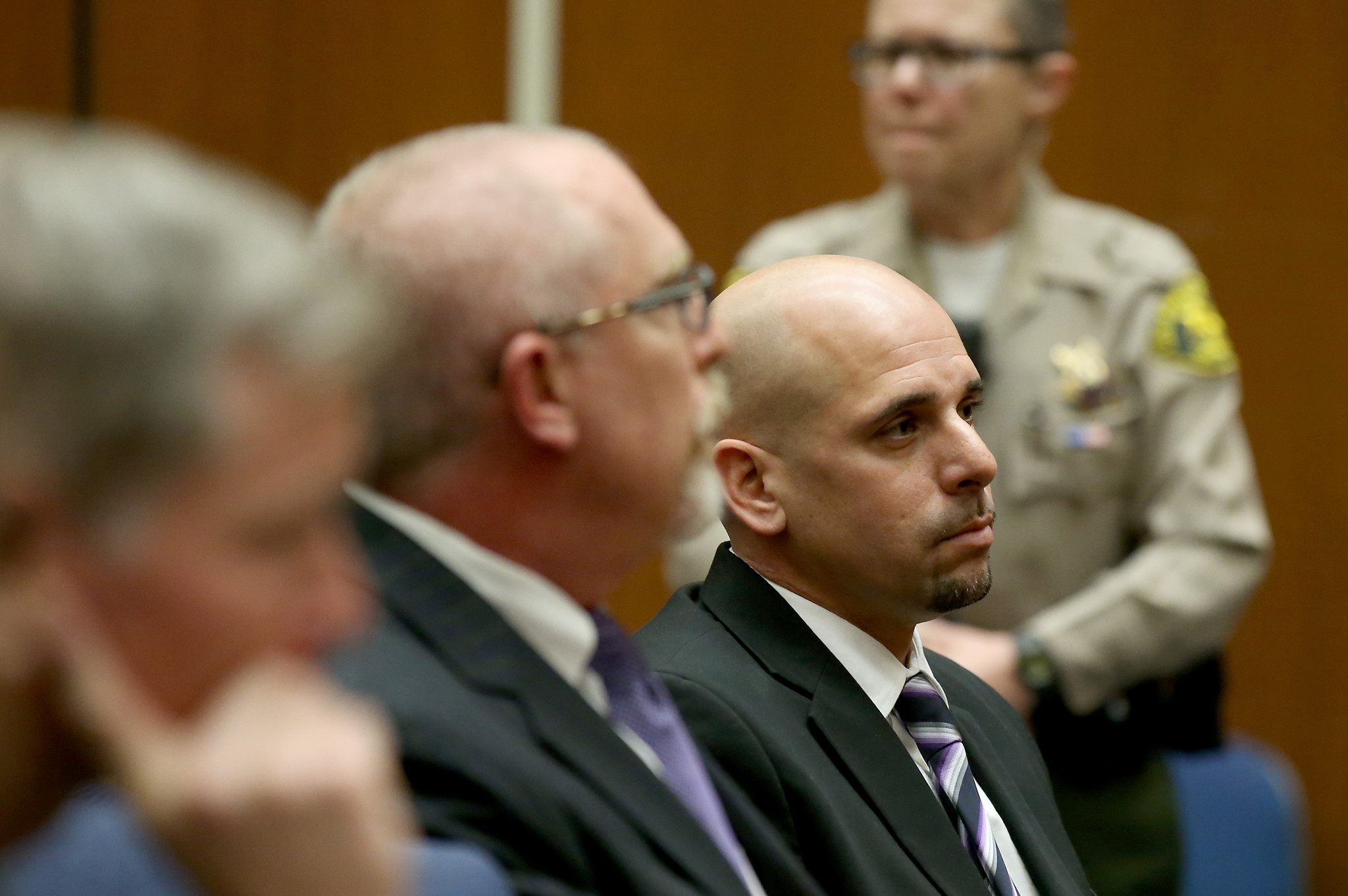 Raymond Lee Jennings, right, attends a hearing in Los Angeles.
