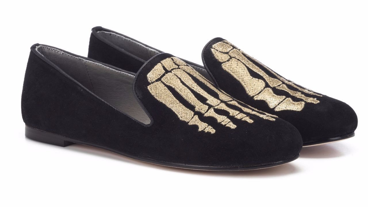 "The ""Jem Skull"" slippers (in black calf hair with an embroidered gold skeleton foot motif) are from Mara & Mine, a brand with Australian ties that's predicated on edgy, sexy looks in flat-heeled shoes. $265, maraandmine.com."