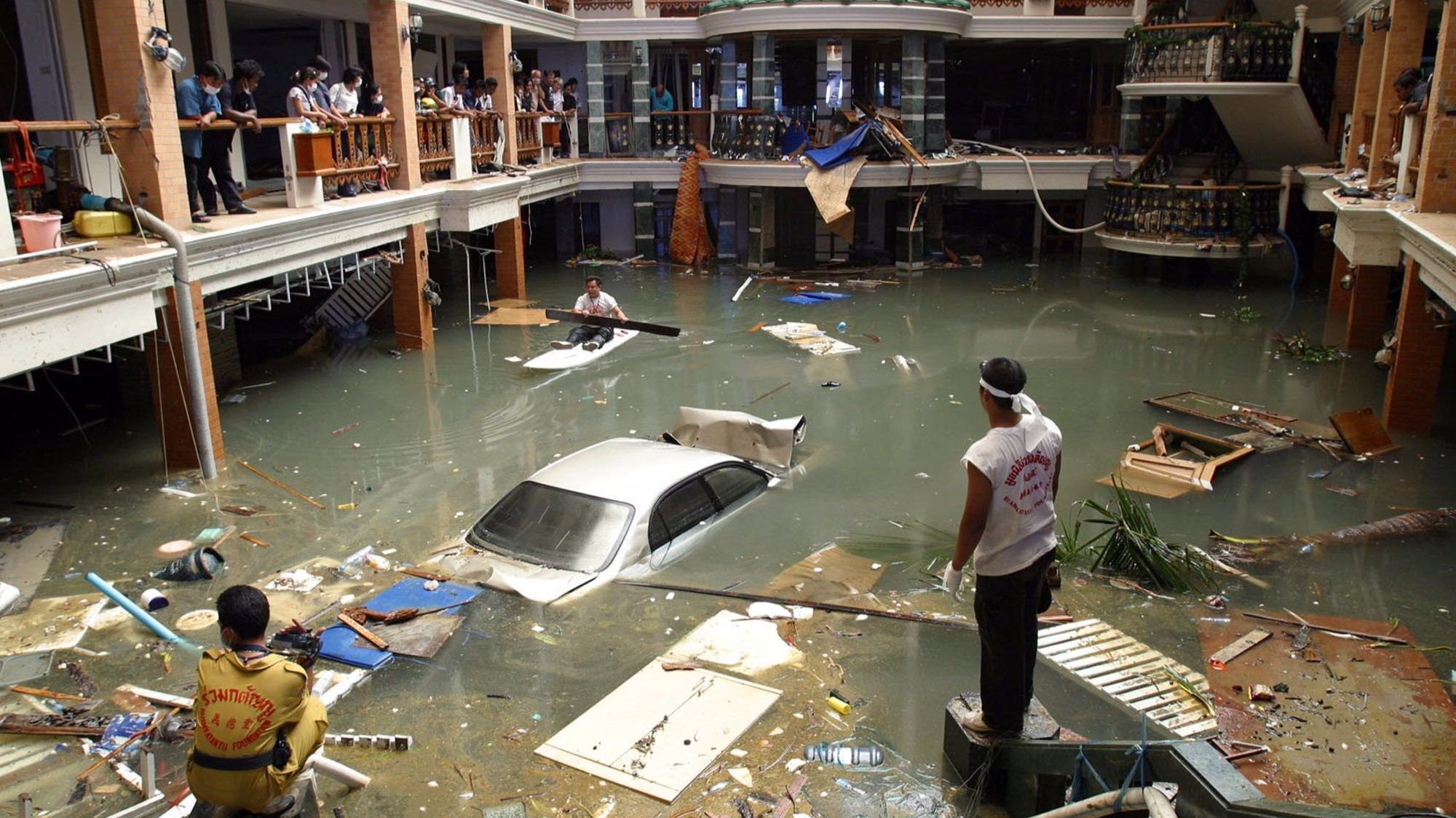 Rescue and cleanup crews survey a flooded lobby at a hotel on Phuket Island in 2004 after massive tsunami waves smashed coastlines.