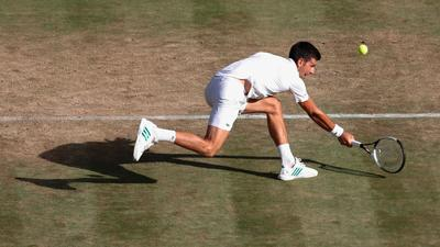 Warm weather makes Wimbledon grass even more challenging