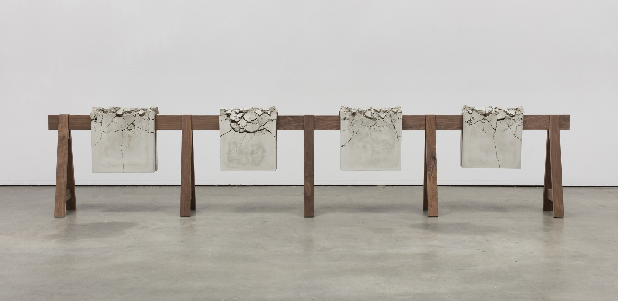 "Analia Saban's ""Draped Concrete (26.25 sq ft),"" 2016. Four concrete slabs on wooden sawhorse, 41-1/4 inches by 192 inches by 16-7/8 inches."