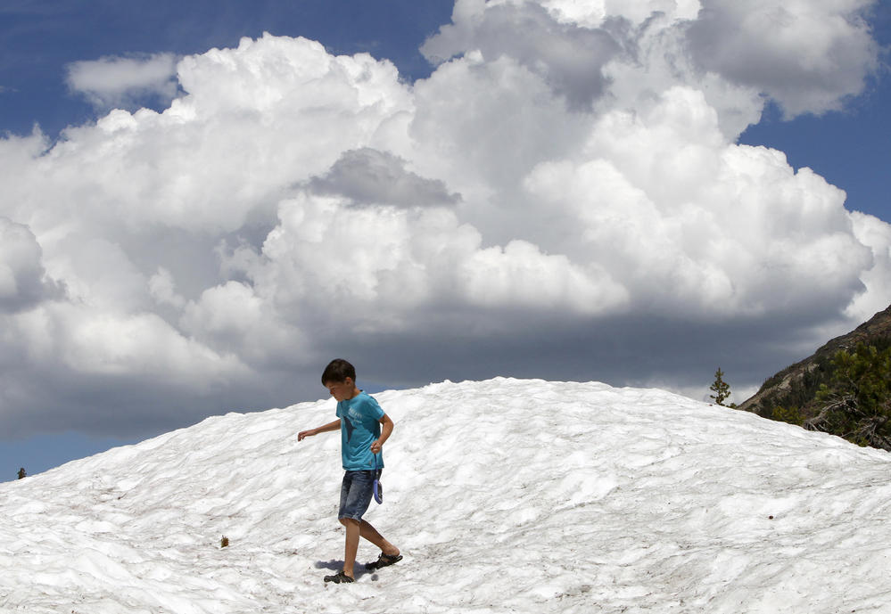 Snowbanks still line the road in early July near Tioga Lake.