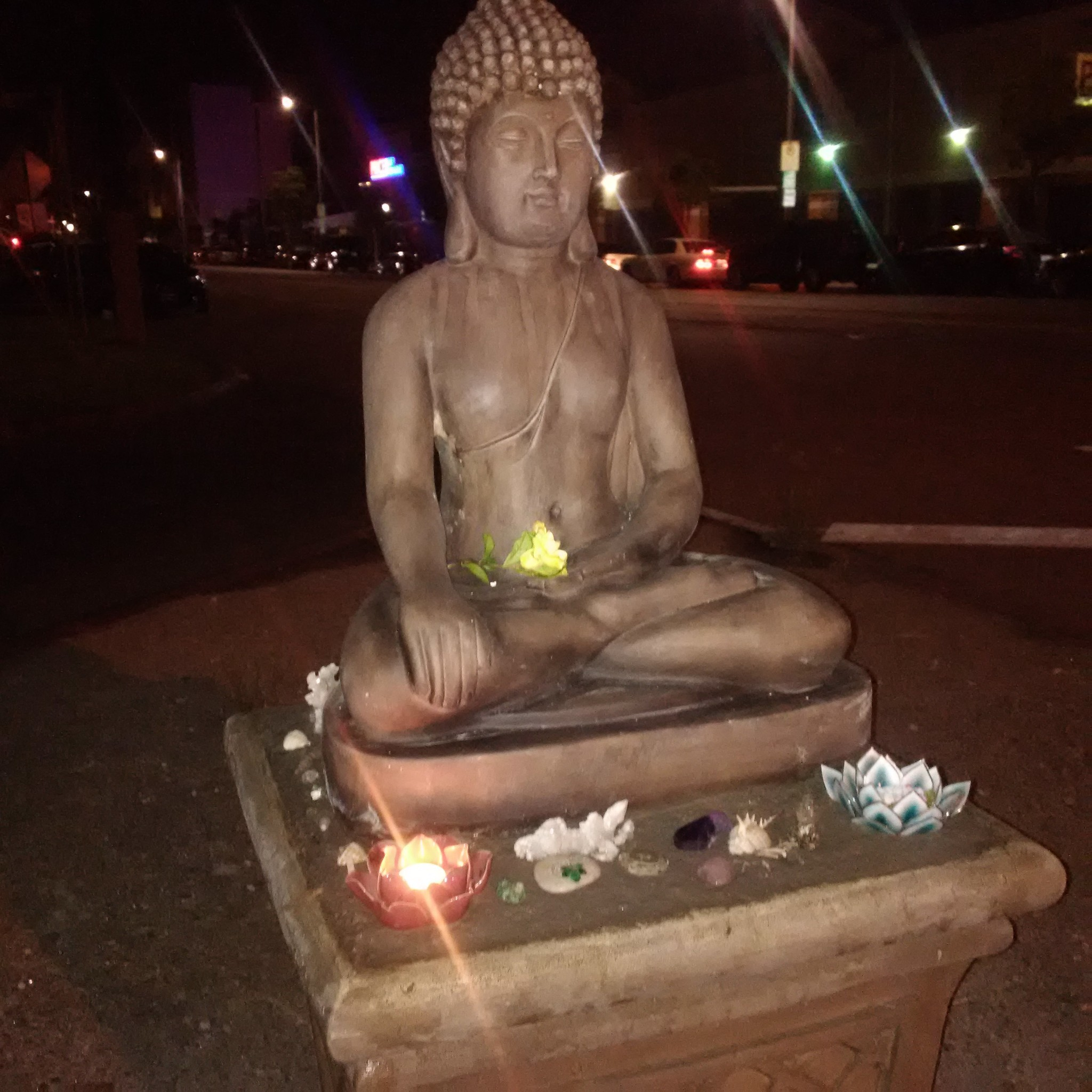 After years of bulky items being left on a traffic island in Palms, someone put a Buddha statue there. Residents treasure the statue, which has been vandalized multiple times.