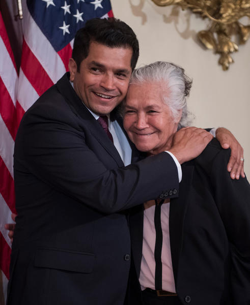 Rep. Jimmy Gomez with mother Socorro Gomez at his swearing-in ceremony. (Tom Williams / CQ Roll Call)