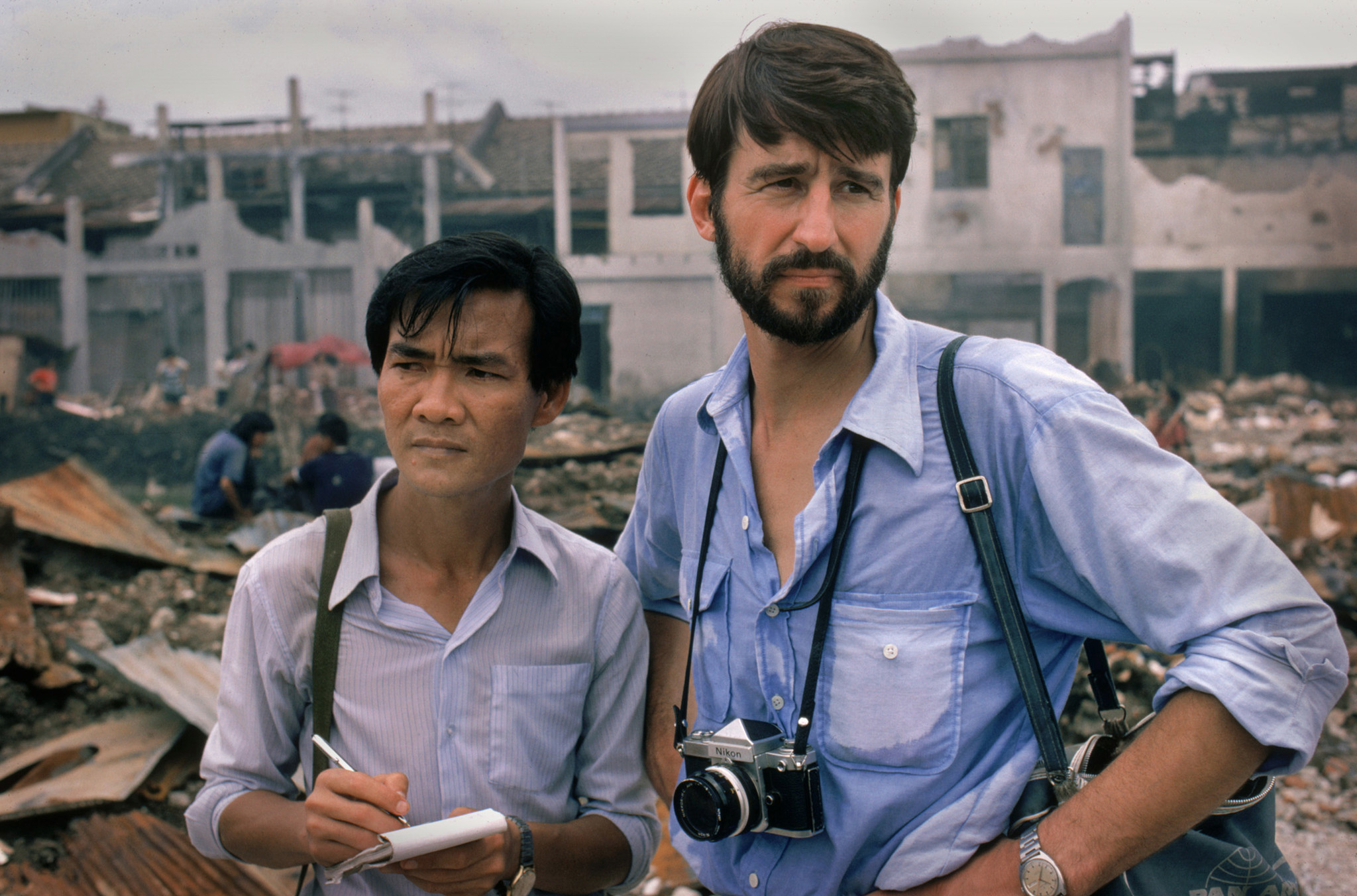 "Haing S. Ngor, left, with Sam Waterston in the 1985 movie ""The Killing Fields."""