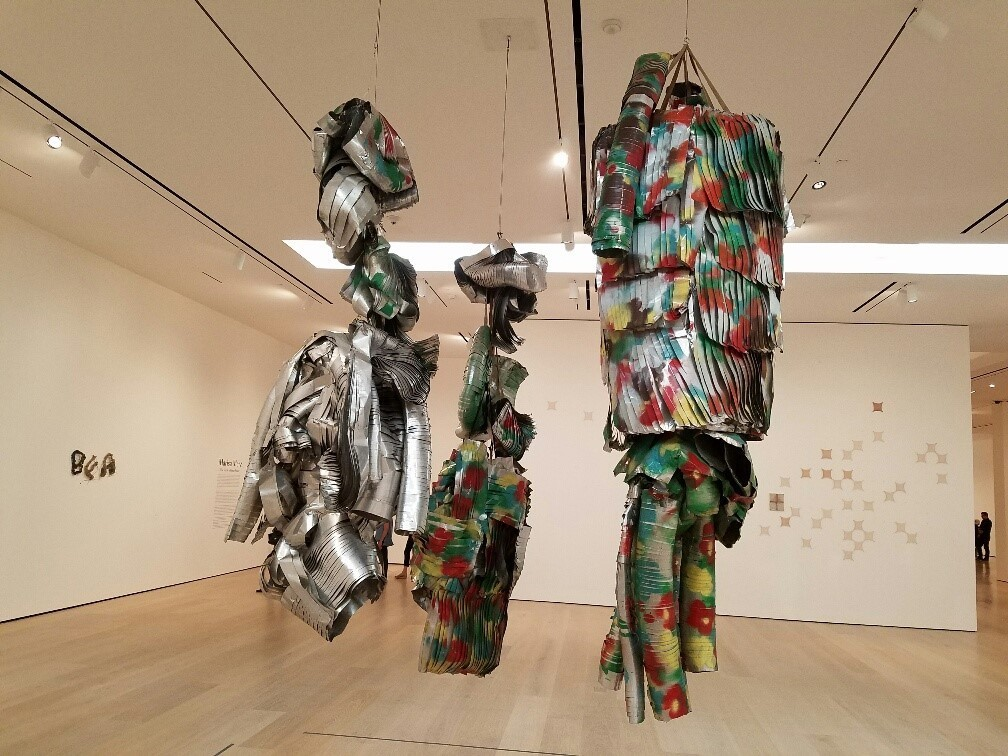 """One puppet-like """"Living Sculpture"""" is spray-painted with Warhol-like flowers."""
