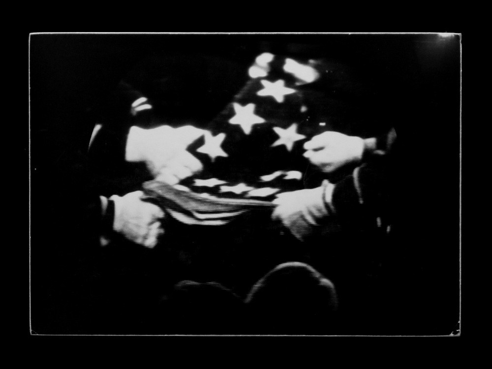 """""""Kennedy Funeral on Television in Suite,"""" 1963, by Dennis Hopper."""