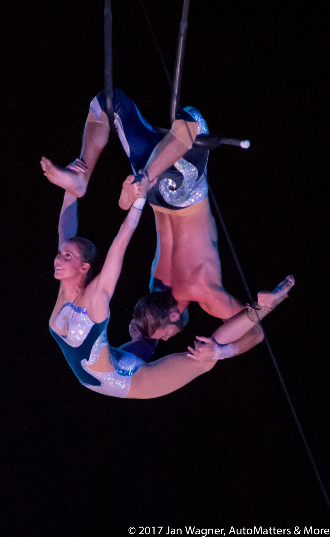 Daring aerialists in the Cirque Electrique Electric Ocean show