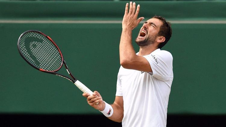 Marin Cilic of Croatia reacts during his loss to Roger Federer of Switzerland in the men's singles f