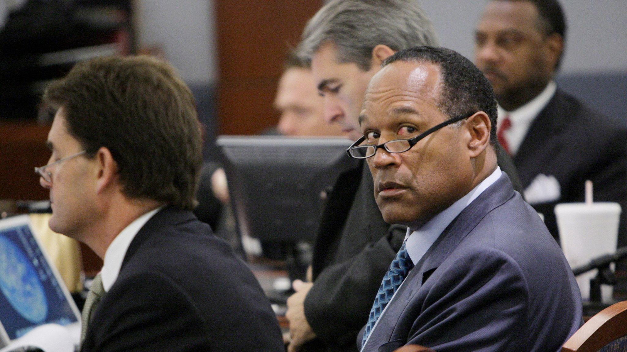Simpson sits with attorneys Yale Galanter and Gabe Grasso at the start of closing arguments during his robbery trial in Las Vegas,