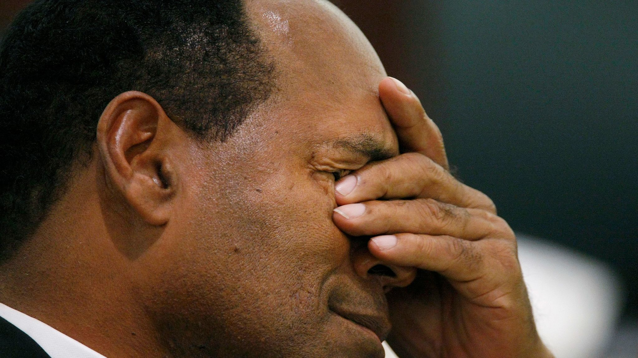 O.J. Simpson rubs his eyes in court during his robbery trial in Las Vegas.