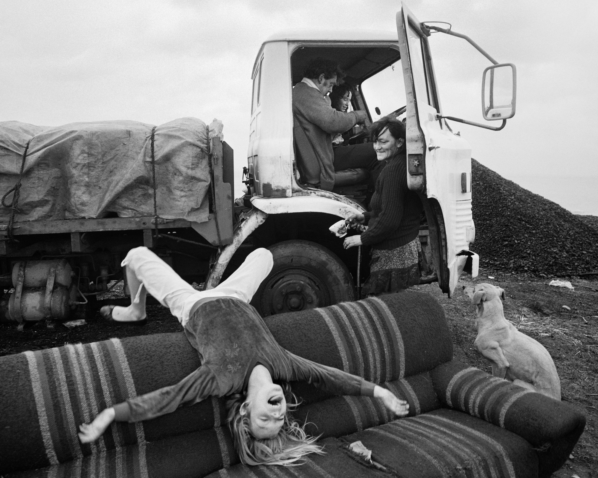 """Helen (upside down), Brian, Alison and Rosie, Seacoal Camp, Lynemouth, Northumberland,"" 1983, by Chris Killip."
