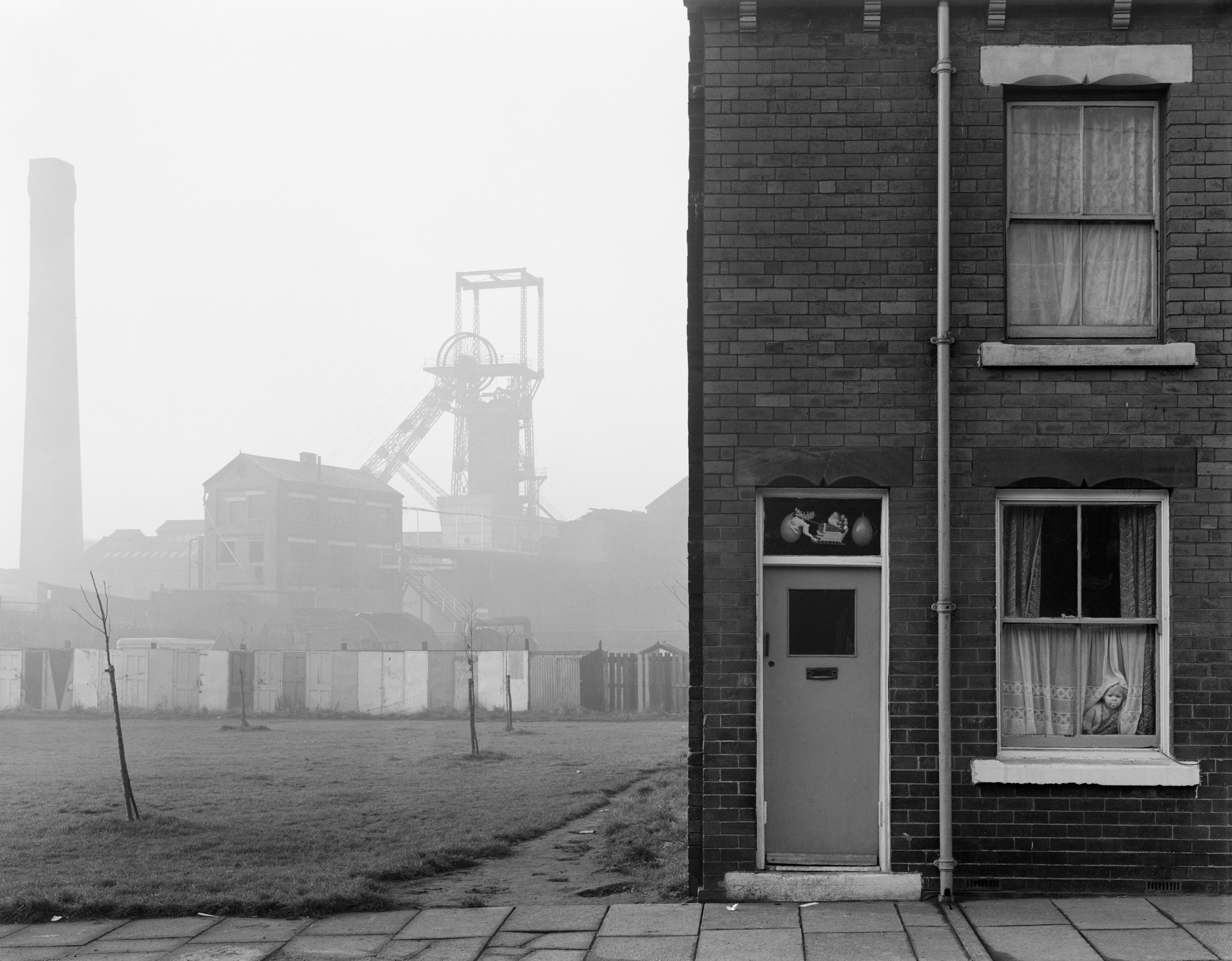 """Terraced House and Coal Mine, Castleford, Yorkshire,"" captured in 1976 by Chris Killip."