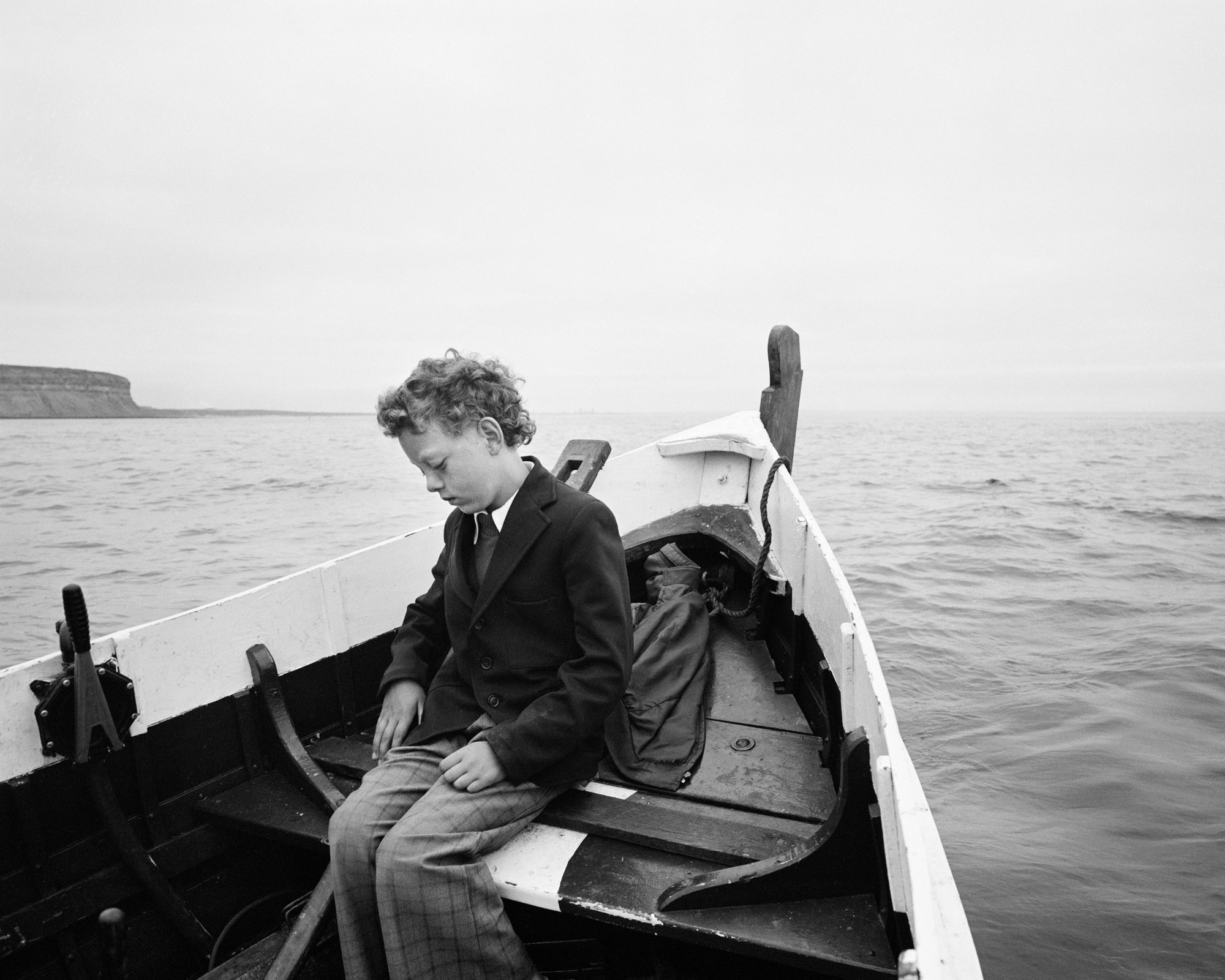 """Simon Being Taken Out to Sea for the First Time Since his Father Drowned, Skinningrove,"" 1983, by Chris Killip."