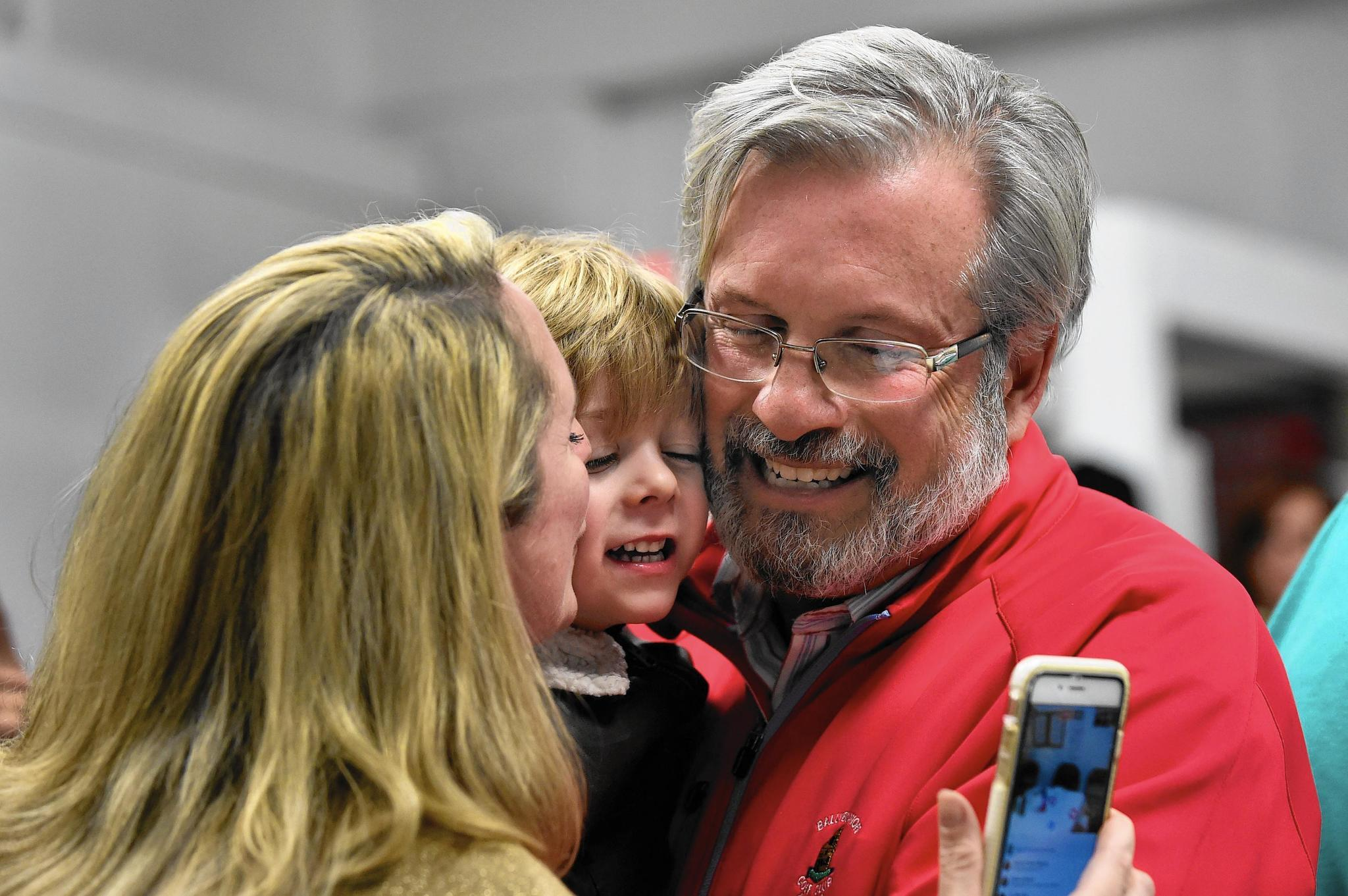 William Petit is congratulated by his wife, Christine, and his son, William, at Republican headquarters in Plainville after winning the 22nd House District House seat in November 2016. Petit defeated 11-term incumbent Democrat Betty Boukus.