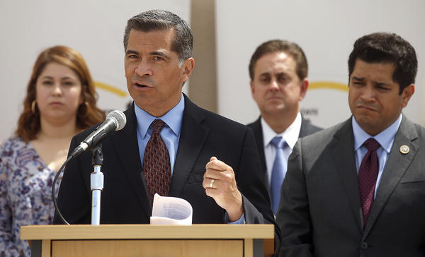 Atty. Gen. Xavier Becerra, left, and Rep. Jimmy Gomez speak about immigration at Cal State L.A. (Mel Melcon / Los Angeles Times)
